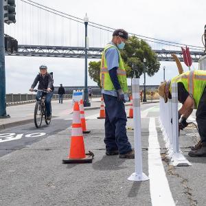 Sign Shop Crew Installing Safe Hit Posts Along New Bicycle Lanes on Embarcadero