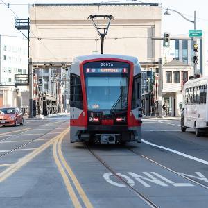 Photo of a Sunnydale-bound T Third train approaching the 4th Street Bridge