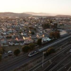 Photo of capitol corridor train and BART train in East Bay