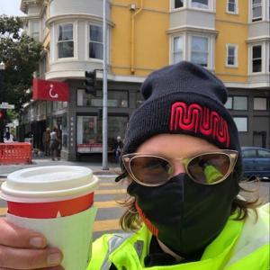Photo of muni staff holding coffee cup