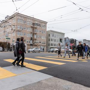 Photo of teenagers crossing a street