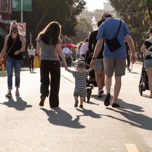 Photo of pedestrians enjoying a street closed to vehicular traffic