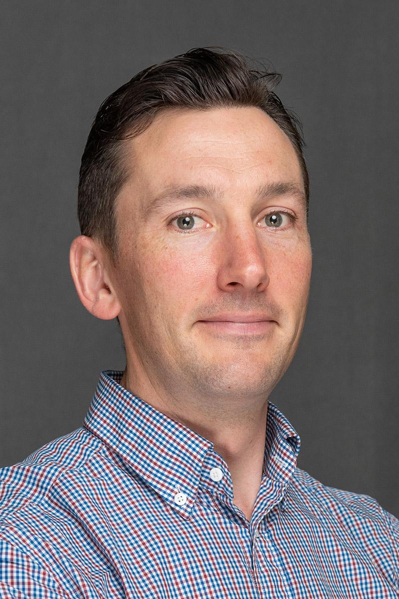 Portrait of Mechanical Systems & Tank Program Engineer John Becker